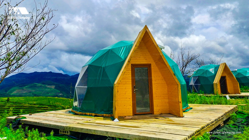 Glamping dome tent with A-frame cabin look door